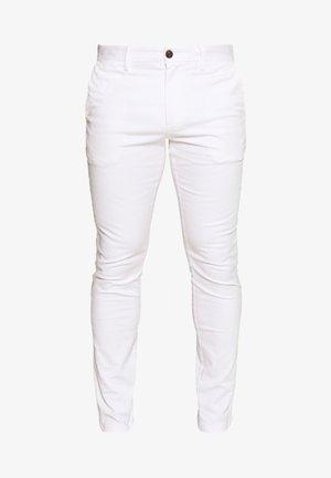 BLEECKER FLEX - Tygbyxor - white