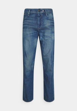 Zúžené džíny - dark blue denim
