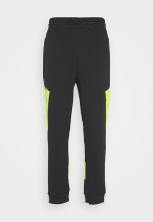 URBAN PANT - Tracksuit bottoms - black/neon green