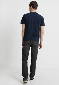Levi's® - 512 SLIM TAPER FIT - Vaqueros tapered - richmond adv - 2