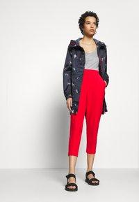 Sisley - TROUSERS - Pantaloni - red - 1