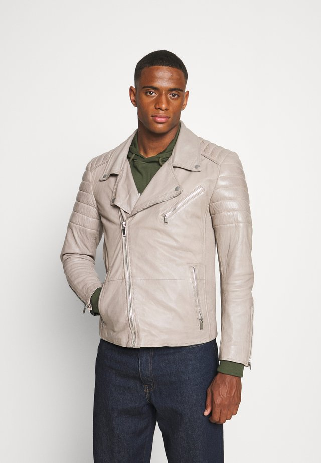 CHARLY ACTION - Leather jacket - soil