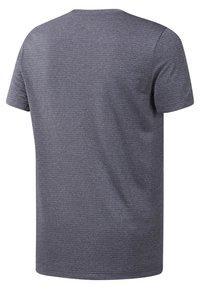 Reebok - WOR MÉLANGE TECH TOP - Print T-shirt - heritage navy - 1
