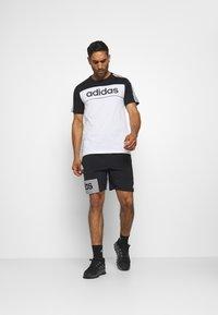 adidas Performance - ESSENTIALS TRAINING SPORTS SHORT SLEEVE TEE - Print T-shirt - black/white - 1