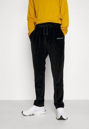 TRACK PANTS UNISEX - Pantalon de survêtement - black