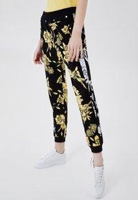 LIU JO - Trousers - black/yellow - 0