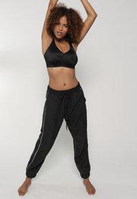 DORINA - Sports bra - black - 1