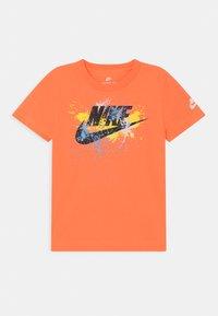 Nike Sportswear - WILD RUN FUTURA  - Print T-shirt - atomic orange - 0