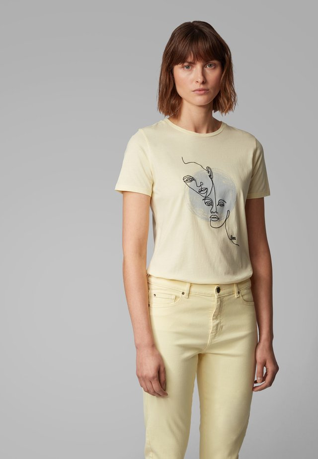 TEVISION - T-shirt con stampa - light yellow