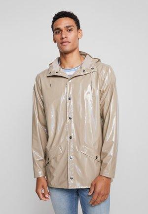 UNISEX HOLOGRAPHIC JACKET - Waterproof jacket - beige