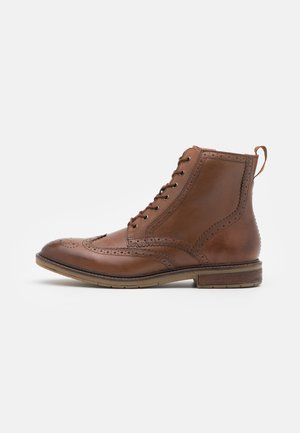 CLARKDALE RISE - Lace-up ankle boots - dark tan