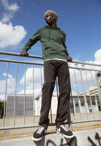 Carhartt WIP - PONTIAC PANT MAITLAND - Straight leg jeans - black stone washed - 1