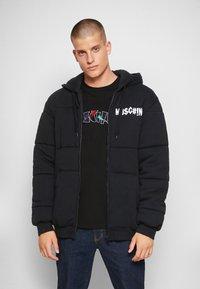 MOSCHINO - Winter jacket - black - 0