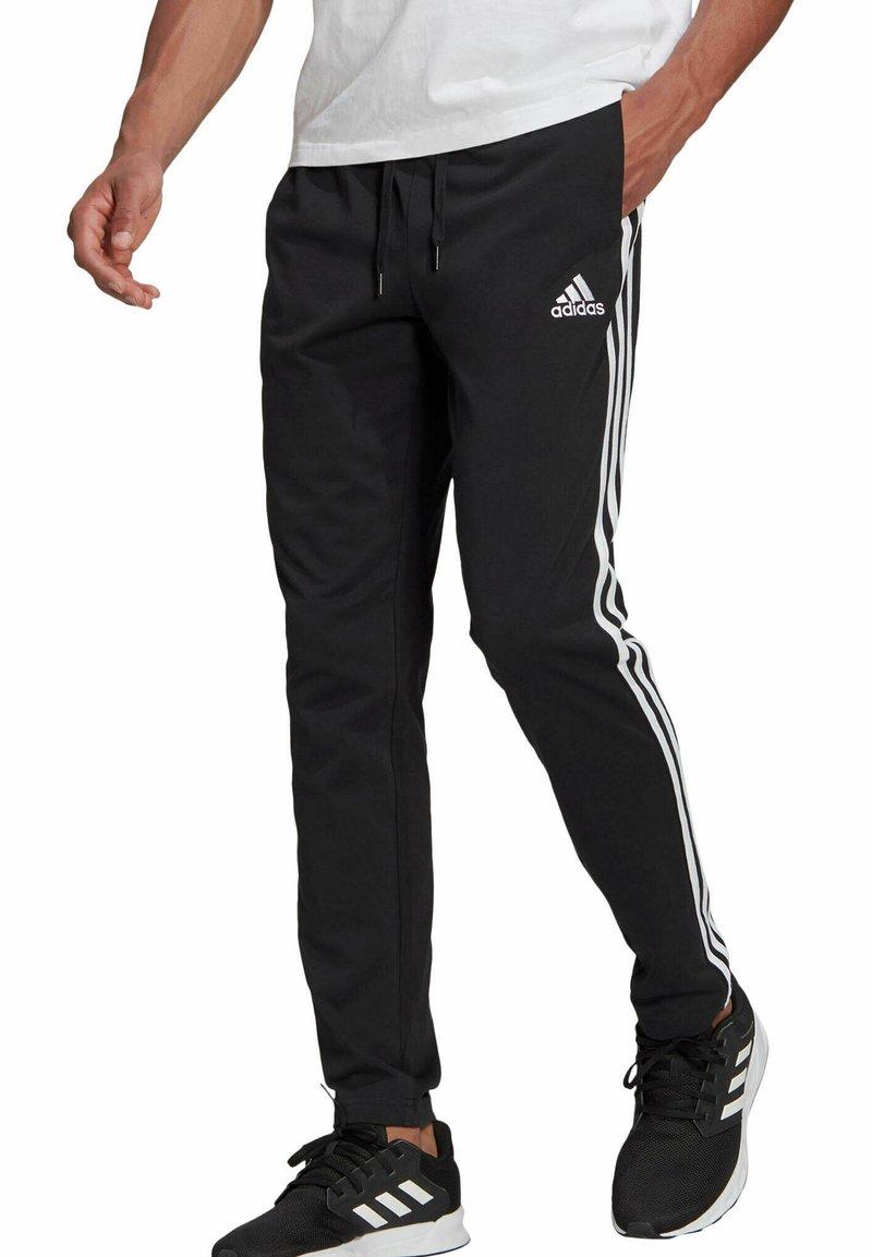 adidas Performance - Tracksuit bottoms - schwarz