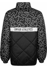 UNFAIR ATHLETICS - DMWU PUFFER - Light jacket - zebra camo - 1
