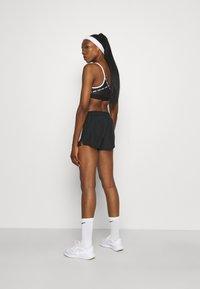 Nike Performance - RUN SHORT - Sports shorts - black/silver - 2