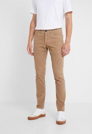 UNITY  - Trousers - deep dune
