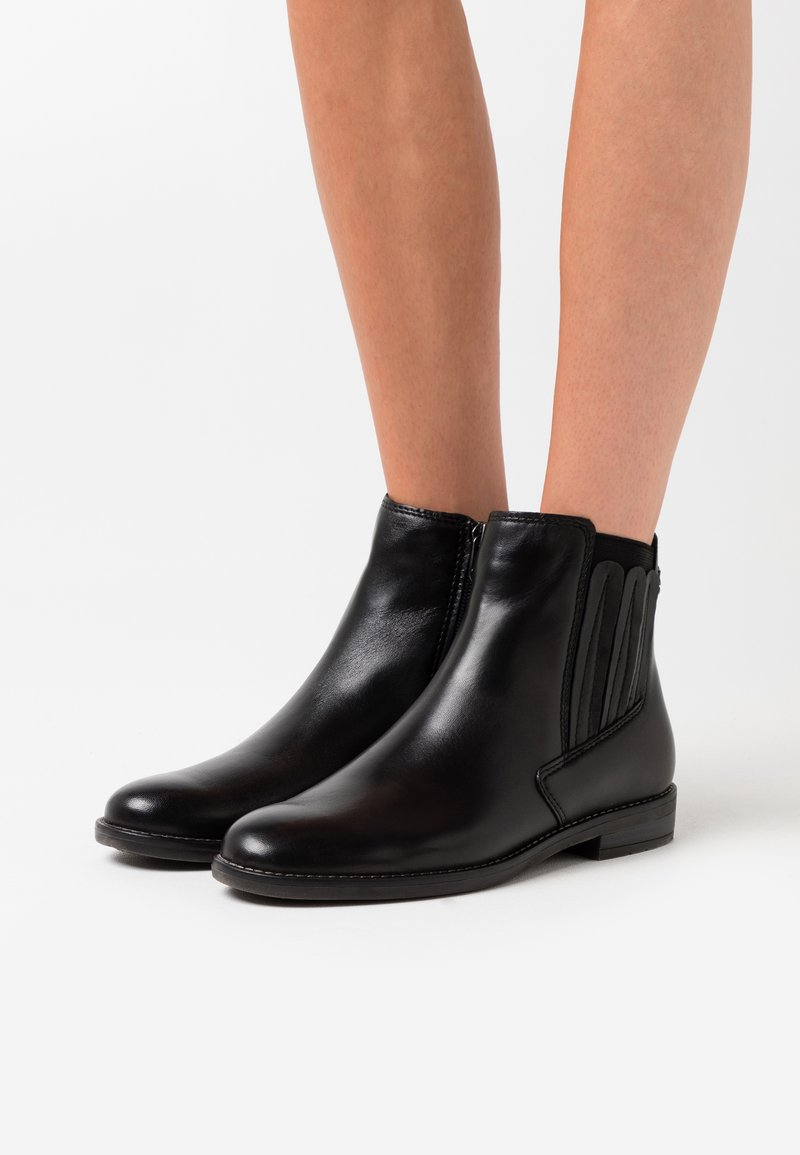 Marco Tozzi by Guido Maria Kretschmer - Ankle boots - black antic