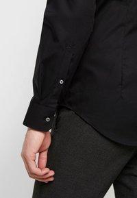 Seidensticker - SLIM FIT SPREAD KENT PATCH - Formal shirt - black - 5