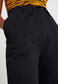 Even&Odd - HIGH WAISTED LOOSE FIT JOGGERS  - Joggebukse - black