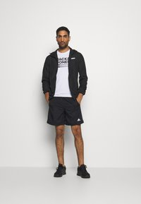 Jack & Jones Performance - JCOZSPORT JACKET - Training jacket - black - 1