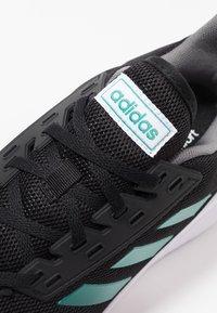 adidas Performance - DURAMO 9 - Neutrala löparskor - core black/active green/grey four - 5