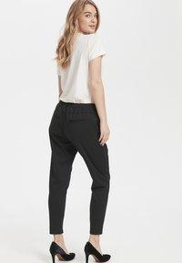 Cream - ANETT PANTS - Trousers - pitch black - 3