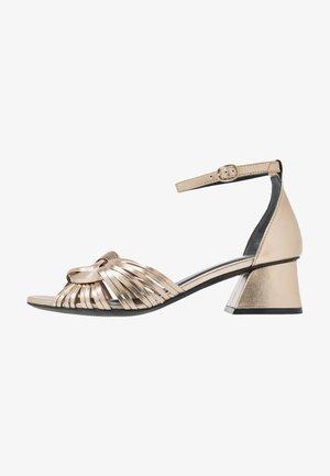 Sandals - metall platino