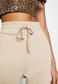 KENDALL + KYLIE - Tracksuit bottoms - beige - 5