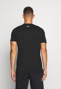 Reebok - GRAPHIC TEE - T-shirts print - black - 2