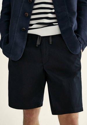 Shorts - blue black denim