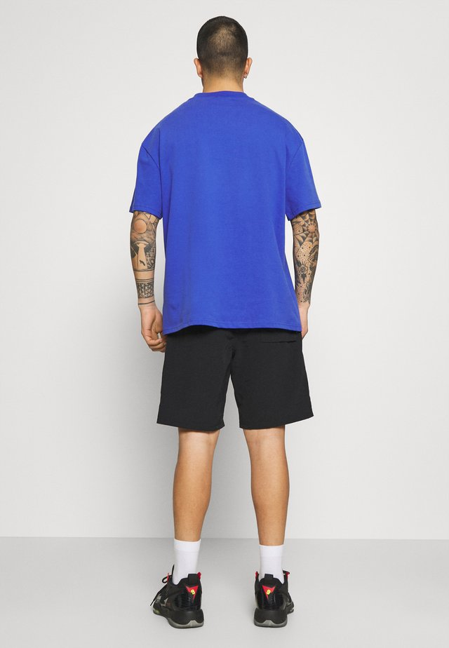 ALL TERRAIN - Shorts - black