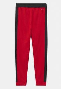 Jordan - JUMPMAN CLASSICS  - Trainingsbroek - gym red - 1