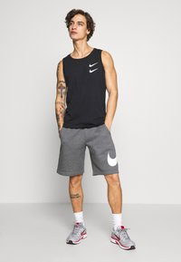 Nike Sportswear - Shorts - charcoal heathr/white - 1