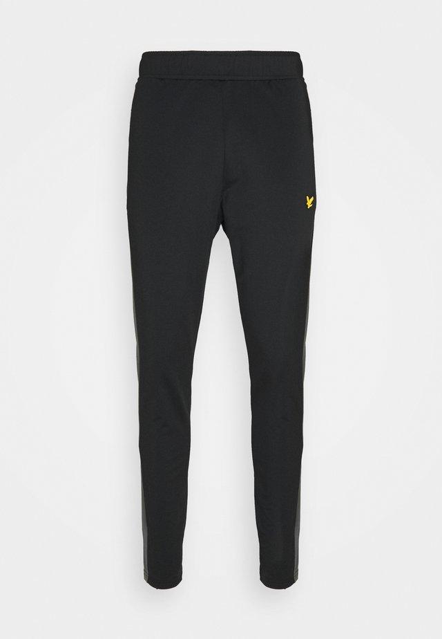 TECH TRACK PANTS - Pantaloni sportivi - true black/rock grey