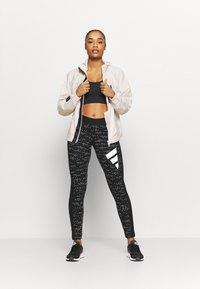 adidas Performance - ADIDAS SPORTSWEAR ALLOVER PRINT LEGGINGS - Medias - black - 1