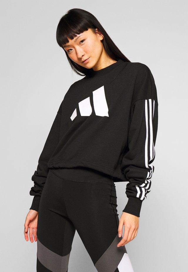 ADJUST - Sweatshirt - black