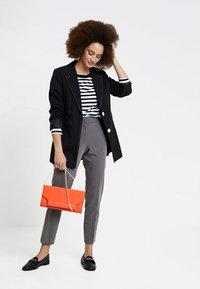 Selected Femme - SLFSTANDARD SEASONAL - Long sleeved top - black/bright white - 1