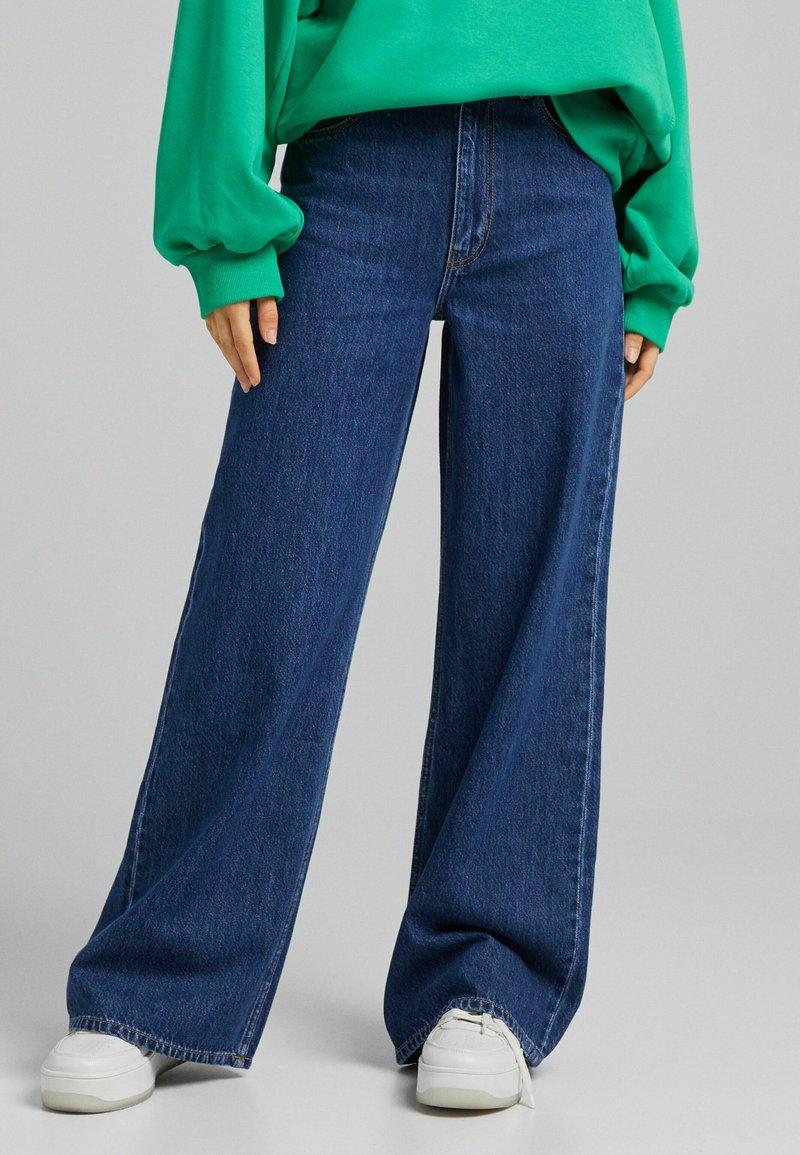 Bershka - Flared Jeans - dark blue