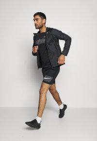 Nike Performance - RISE - Print T-shirt - black/sail - 1