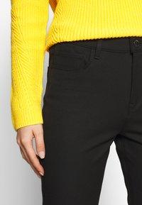 Tommy Hilfiger - GABARDINE PANT - Trousers - black - 4