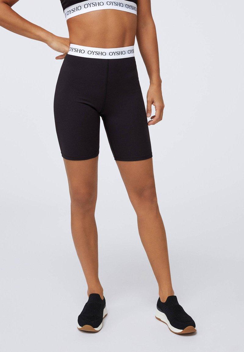 OYSHO - kurze Sporthose - black