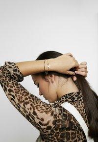 Swarovski - MICKEY & MINNIE BANGLE - Armband - gold-coloured - 1