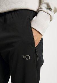 Kari Traa - TIRILL PANT - Tracksuit bottoms - black - 5