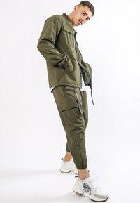 Ed Hardy - URBAN-TIGER NYLON POLY STRETCH SHACKET - Summer jacket - khaki - 1