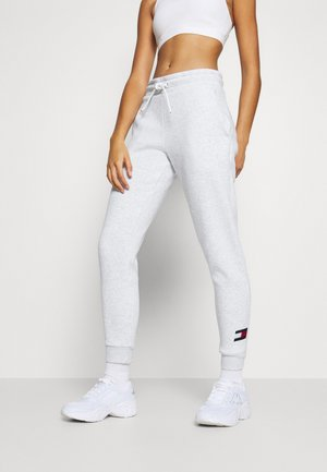 CUFFED FLAG LOGO - Tracksuit bottoms - white