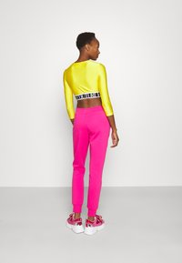 Versace Jeans Couture - PANTS - Tracksuit bottoms - pink - 2