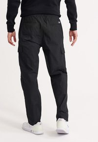 Superdry - UPERDRY NYCO PANTS - Cargo trousers - black - 2