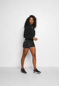 Ellesse - VENO SHORT - Pantalón corto de deporte - black - 1