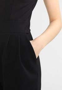 WAL G. - RUFFLE JUMPSUIT WITH BACK INSERT - Jumpsuit - black - 6